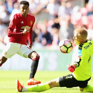 LONDON, ENGLAND - AUGUST 07: Jesse Lingard of Manchester United scores his sides first goal past Kasper Schmeichel of Leicester City during The FA Community Shield match between Leicester City and Manchester United at Wembley Stadium on August 7, 2016 in London, England. (Photo by Alex Morton - The FA/The FA via Getty Images)